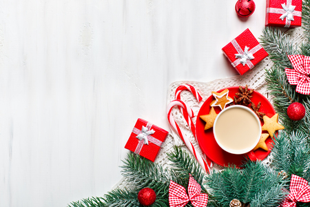 Merry Christmas and happy New year. Cup of cocoa, gifts and fir-tree branches on a white wooden table. Selective focus. Christmas background. Horizontal. Background with copy space. Top view. Stock Photo
