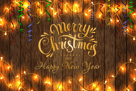 Merry Christmas and happy New year. Christmas garland on a wooden background.