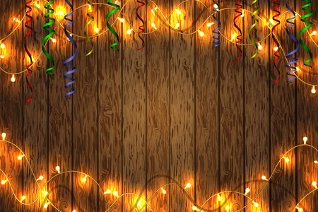 Merry Christmas and happy New year. Christmas garland on a wooden background. Background with copy space. Stock Photo