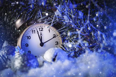 Merry Christmas and happy New year. Clock indicating the outgoing year. Horizontal. Christmas background. Stock Photo