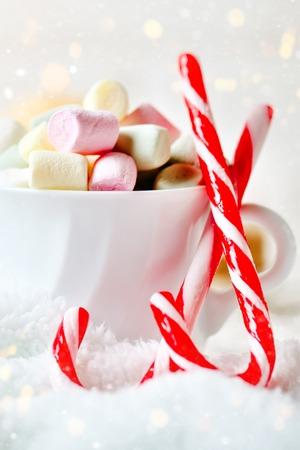 Merry Christmas and happy New year. Cup of cocoa and marshmallows on a light background. Christmas background. Stock Photo
