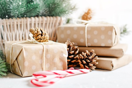 Merry Christmas and happy New year. Christmas gifts on light background. Selective focus. Christmas background.