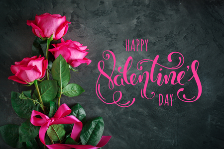 Card for St. Valentines Day, Mothers Day. Day of Womans. Pink roses against a dark background.