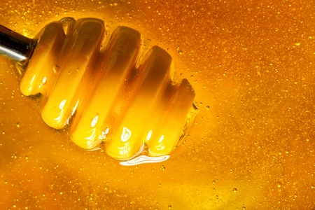 Honey with gold color flows down from a spoon. Healthy food concept. Healthy eating. Diet. Selective focus.