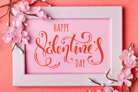 Valentines day. Greeting card on coral background. Selective focus. Horizontal. Stock Photo