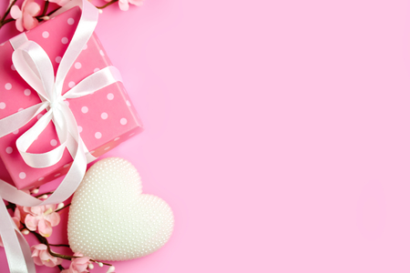 Greeting card on pink background. Selective focus. Valentines day, Womens day, Mothers day. Background with copy space. Horizontal.