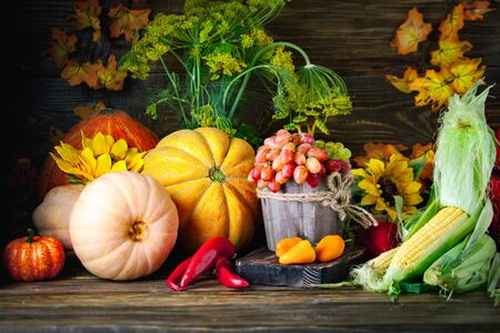 The table, decorated with vegetables and fruits. Harvest Festival. Happy Thanksgiving. Autumn background. Selective focus. Stockfoto - 128606677