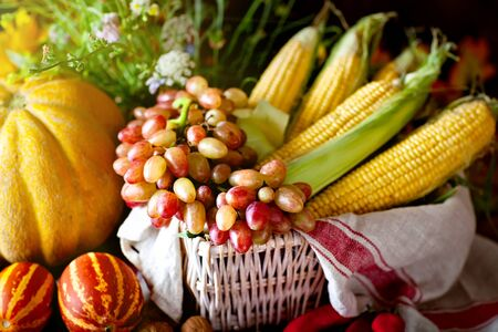 The table, decorated with vegetables and fruits. Harvest Festival. Happy Thanksgiving. Autumn background. Selective focus.