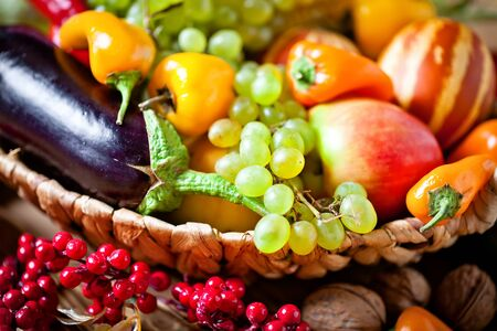 The table, decorated with vegetables and fruits. Harvest Festival. Happy Thanksgiving. Autumn background. Selective focus. Stockfoto - 128606910