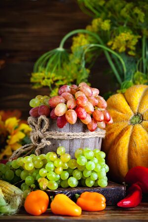 The table, decorated with vegetables and fruits. Harvest Festival. Happy Thanksgiving. Autumn background. Selective focus. Archivio Fotografico - 149396097