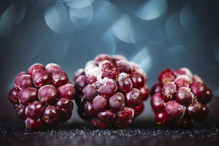 Frozen blackberries on a wooden table. Horizontal. Archivio Fotografico