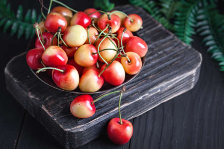 Fresh cherry in a Cup on a dark rustic wooden table. Background with space for copying. Selective focus. Archivio Fotografico - 151214998