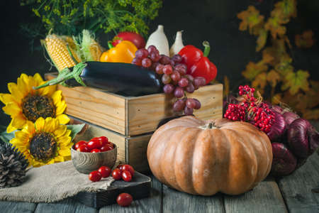 The table, decorated with vegetables and fruits. Harvest Festival,Happy Thanksgiving. Autumn background. Selective focus.