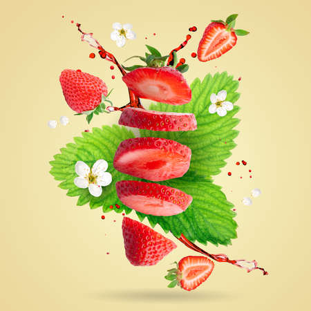 Strawberry berries levitating on a yellow background. Strawberry background.