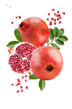 Ripe pomegranates levitate on a white background. Background with pomegranate fruit. Vertical.