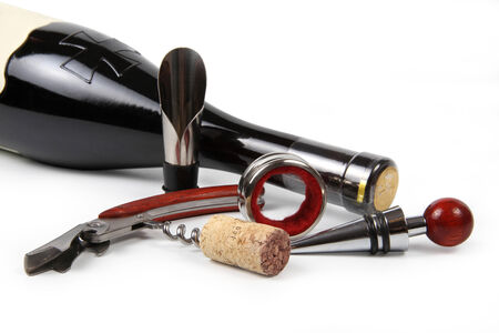 A set of wine accessories in a white background