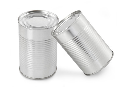 The closed tin cans on a white background photo