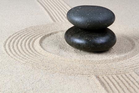 Stones on raked sand photo
