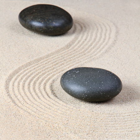Stones on raked sand photo