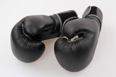 A two boxing glove on a white  photo