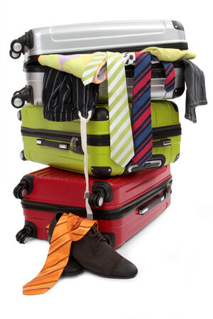 luggage pieces: travel suitcase with personal belongings isolated on white