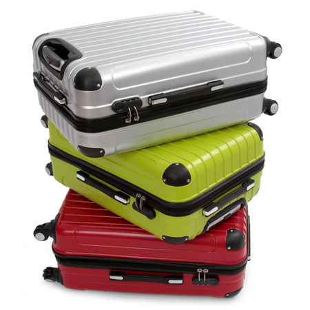 Luggage consisting of three polycarbonate suitcases isolated on white  Standard-Bild