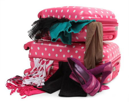 pink travel suitcase with personal belongings isolated on white  Stock Photo