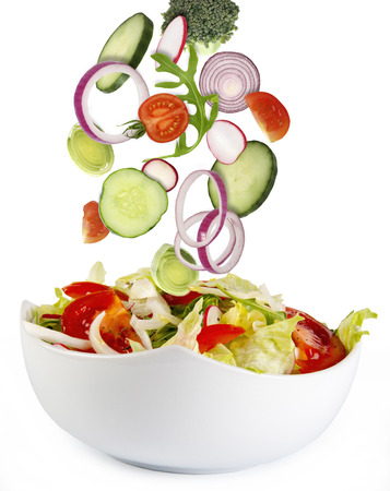 Fresh salad with ingredients isolated on white photo