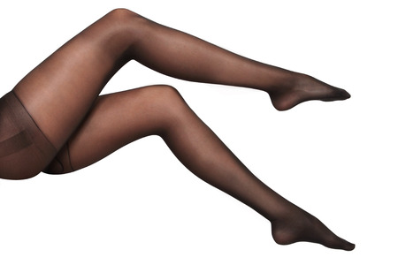long sexy legs: black stockings on sexy woman legs isolated on white  Stock Photo