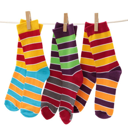 colored socks on the clothesline isolated on white  Standard-Bild