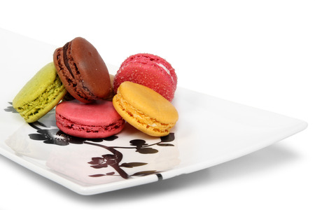 A plate of traditional french macaroons on a white background photo