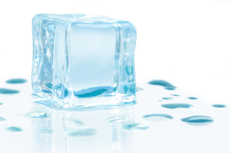 ice cubes with water drops isolated on white background photo