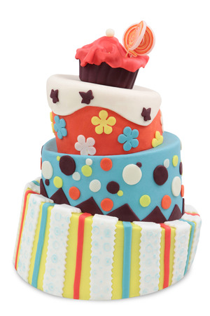 crazy cake decorated with fondant - isolated on white background photo