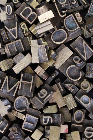 typesetter: Old metal letterpress printing blocks
