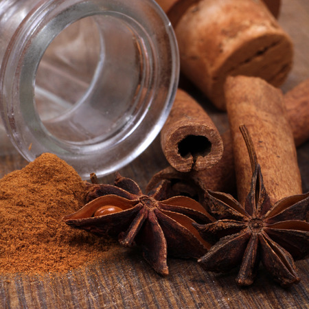 anice: Cinnamon sticks and anice close up on wooden table Stock Photo