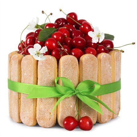 isoleted: cherry sponge cake with fresh fruits decoration isoleted on white background