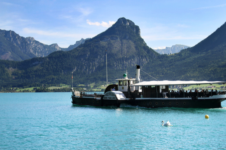 kaiser: ST. WOLFGANG, AUSTRIA - AUGUST 28, 2015: Steamboat Kaiser Franz Josef I. on the Lake Wolfgangsee, Austria. The ship was built in 1886.