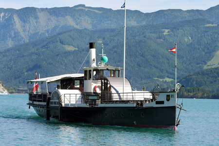 steamboat: ST. WOLFGANG, AUSTRIA - AUGUST 28, 2015: Steamboat Kaiser Franz Josef I. on the Lake Wolfgangsee, Austria. The ship was built in 1886.