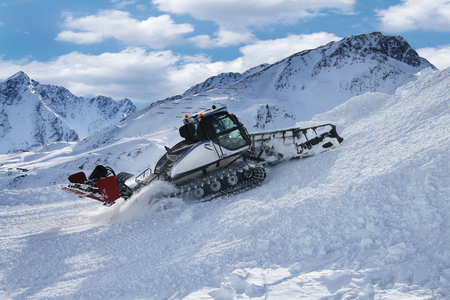 Ratrac snowcat machine on snow hill ready for skiing slope preparations in Austrian Alps. Reklamní fotografie