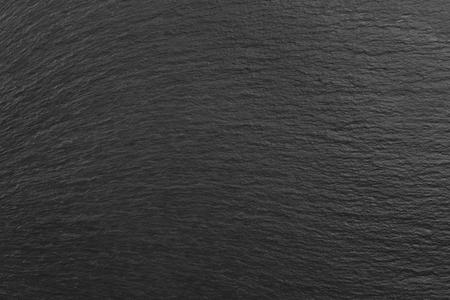 Dark grey black slate background or natural stone