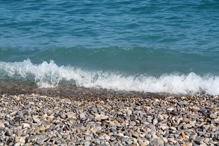 Soft wave on pebble beach Reklamní fotografie