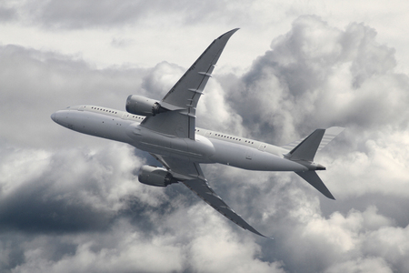 Passenger airplane over the clouds
