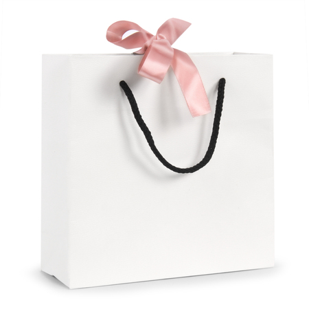 White paper bag with pink ribbon on a white background