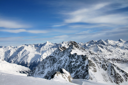 Landscape of mountains in winter with blue sky