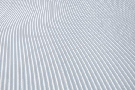 Skiing background - fresh snow on ski slope. Powder, alps. Reklamní fotografie