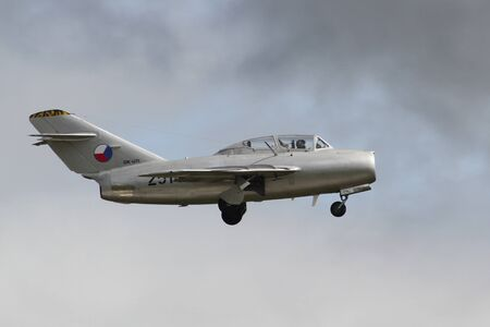 HRADEC KRALOVE, CZECH REPUBLIC - SEPTEMBER 5: Jet fighter aircraft Mikoyan-Gurevich MiG-15 developed for the Soviet Union rolling. Display, clouds.