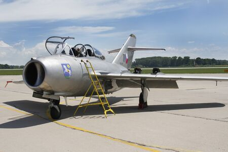 Pardubice Airshow, CZECH REPUBLIC - June 2 2019: Jet fighter aircraft Mikoyan-Gurevich MiG-15 developed for the Soviet Union rolling. Display, clouds.