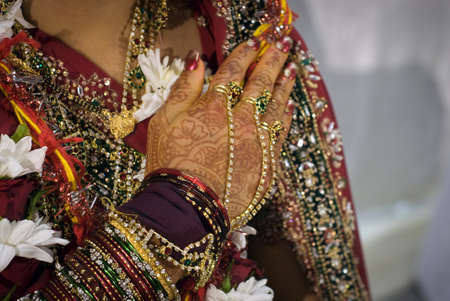 Closeup detail of jewellery and traditional wedding costume on an Indian bride Stock Photo - 13602024