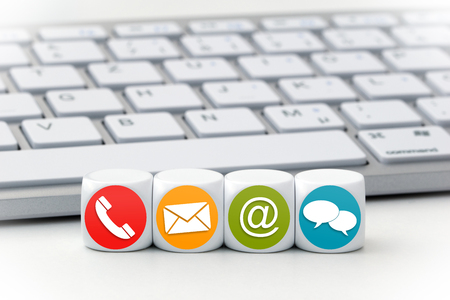 Website and Internet contact us page concept with colored icons on cubes Stock Photo