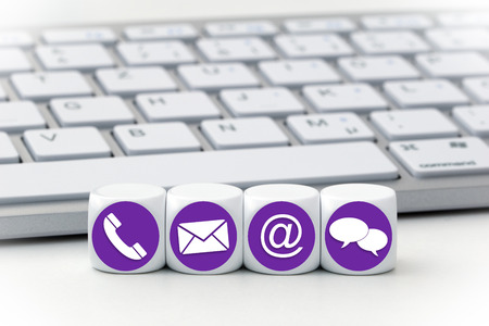 Website and Internet contact us page concept with colored icons on cubes Standard-Bild